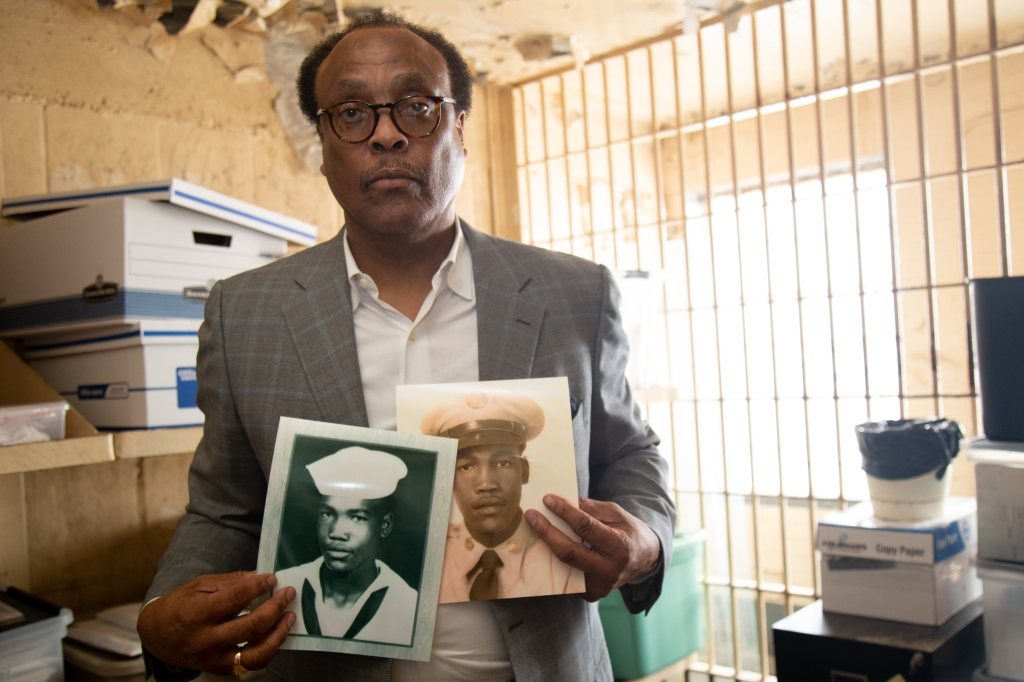 From the former jail cell where Marvin Leonard Williams was found dead, Ronnie Williams displays military photos of his brother.